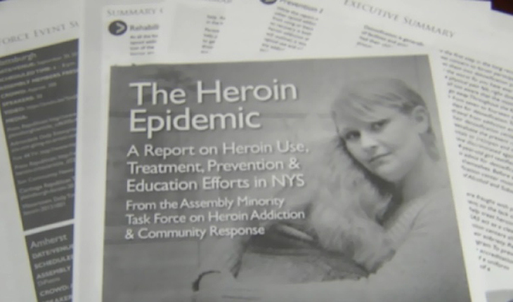 "Picture of newspaper with headline ""The Heroin Epidemic"""